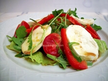 Arugula (rocket), iceberg lettuce and mozzarella salad with orange juice sauce